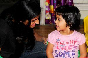 preschool teacher with student